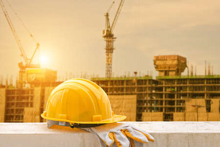 yellow hard hat on construction site Imagens