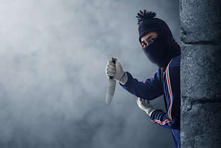 Criminal or bandit holding a knife. Stock Photo