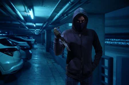 Criminal or bandit holding a knife. 版權商用圖片