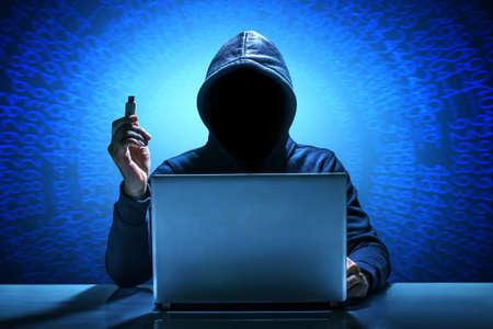 Hacker using laptop. Hacking the Internet. 版權商用圖片