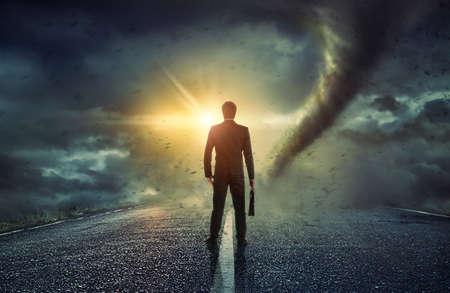 Businessman watching a tornado. Concept for success.