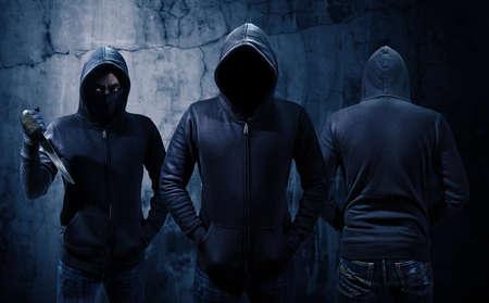 Gang of robbers or burglars dressed in black