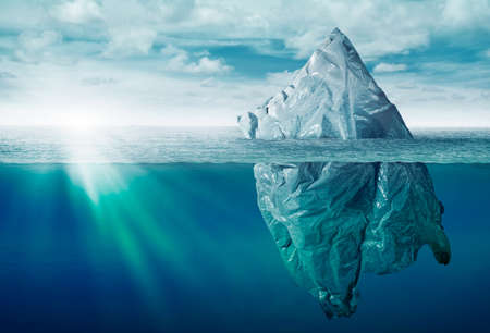 plastic bag environment pollution with iceberg of trash Imagens
