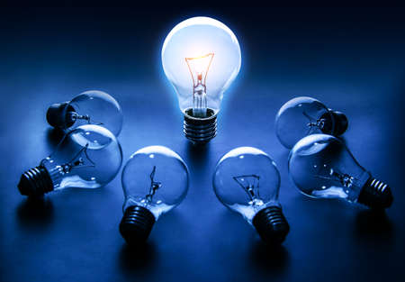 Light bulb lamps on a colour background 版權商用圖片