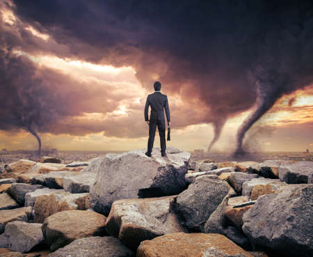 Businessman watching a tornado. Concept for success.
