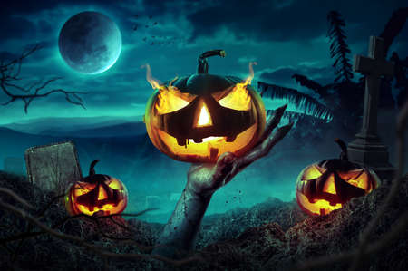 Zombie hands rising in dark Halloween night. 版權商用圖片