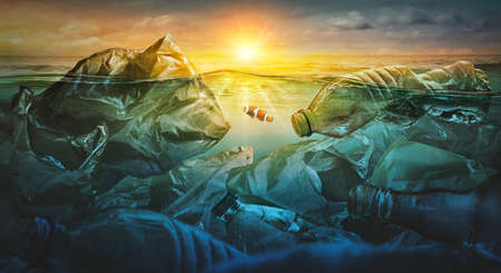 Fish swims among plastic bag ocean pollution. Environment concept