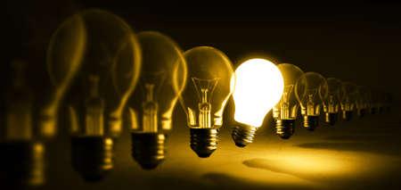 Glowing light bulb on orange background, idea concept