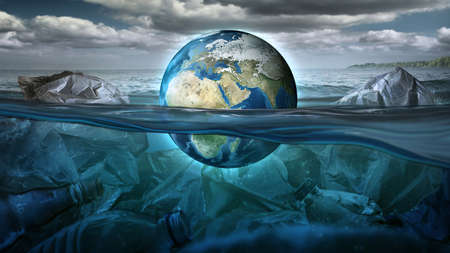 The Earth floats in the sea full of garbage and pollution. Environment concept.