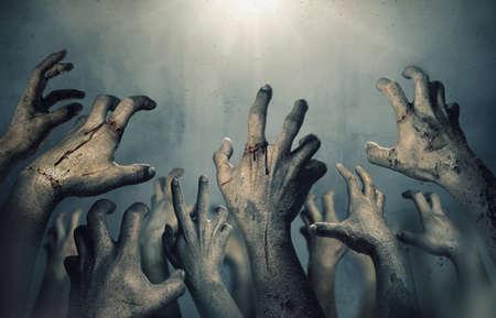 Zombie hands rising in dark Halloween night. Imagens