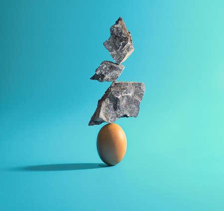 Three stones put on Egg. creative idea. Balance concept
