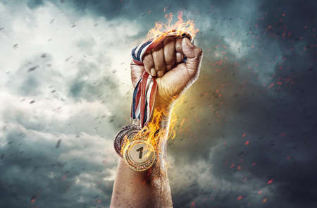 Medal for the first place on sky background. Victory concept. Fire and energy
