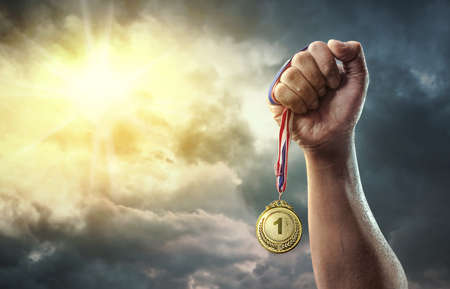 Medal for the first place on sky background. Victory concept