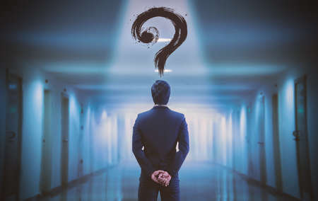 A businessman with a question mark on his head Imagens