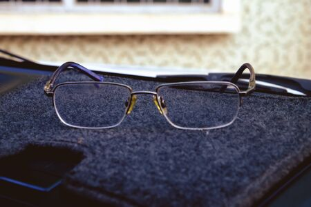 industrious: Glasses on a control. retro