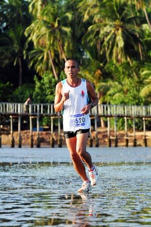 Chumphon Province, Langsuan District, Thailand, 22  Sunday July 2012 : Annual run through the sea to pithak island (Unseen Thailand) LangSuan Mini Marathon 8 th.