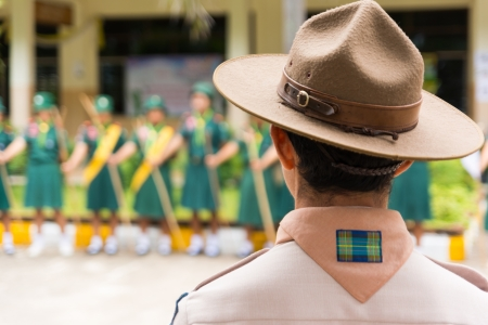 Scouter and girl senior scout trooping at outdoor  Shallow DOF Standard-Bild