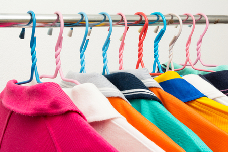 Colorful T-shirts on hangers photo