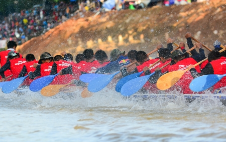 CHUMPHON, THAILAND-OCT 22  Unidentified rowers in Climbing Bows toward Snatching a Flag native Thai long boats compete during King s cup Native Long Boat Race Championship on Oct 22, 2013 in Chumphon, Thailand