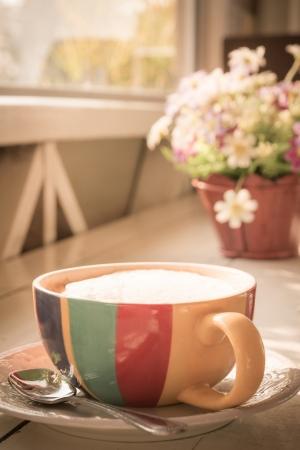 tea filter: Cup of milk tea with flowers, retro filter effect