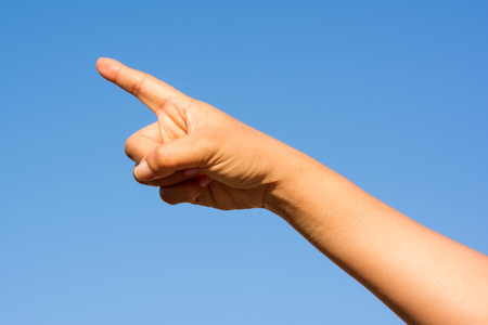 wag: hand on blue sky Stock Photo