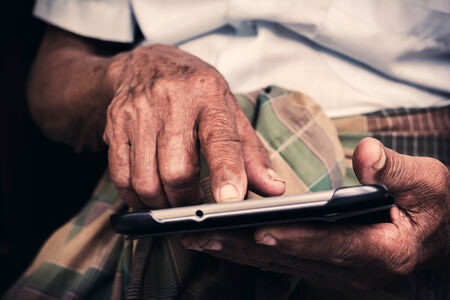 senior playing tablet photo