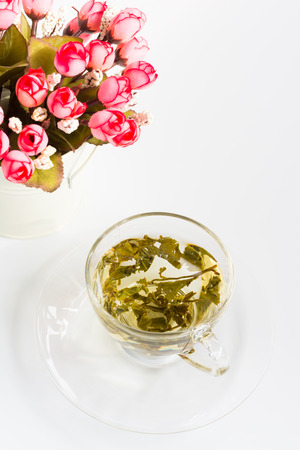 tea and flower on white photo