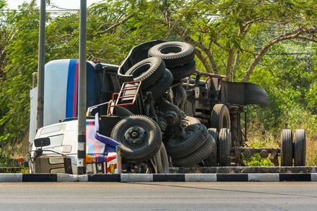 overturned truck accident on highway road photo