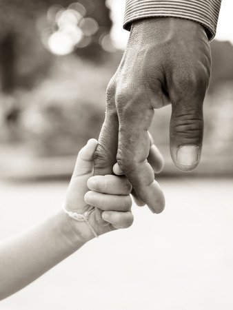 father with children: Father giving hand to a child