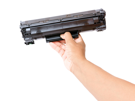 Laser printer cartridge in hand Stock Photo