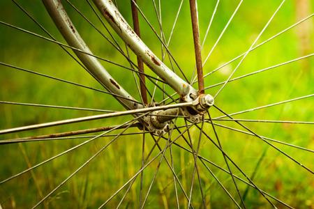 old bicycle wheel vintage background photo