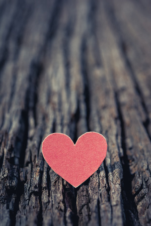 Red Valentine heart on old rustic wooden background. Valentine