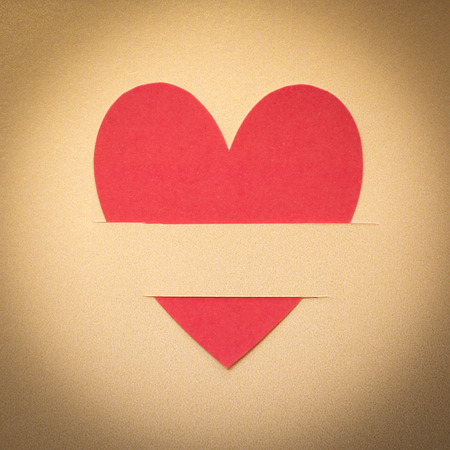 Paper hearts on gold paper background photo