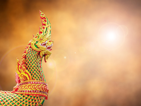 naga china: Thai dragon or king of Naga statue on retro abstract background