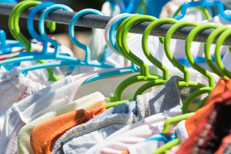 swaddle: Drying cloth and swaddle on hanger Stock Photo