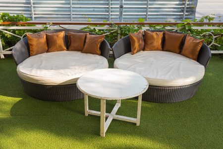 love seat: A modern wicker garden sofa or love seat