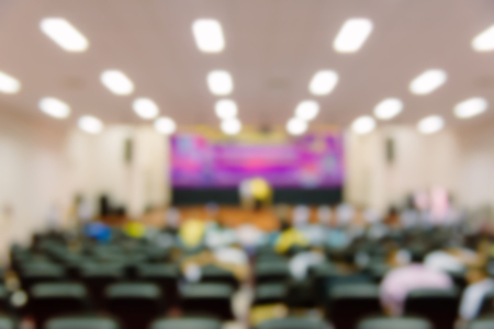 Defocused and blur image of people are watching the show in the auditorium. Stock Photo