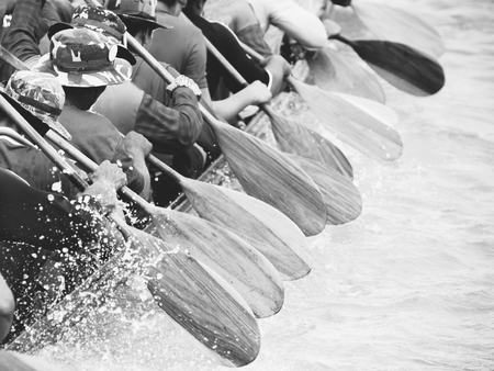 robust: Close up of rowing team race with black and white effect Stock Photo