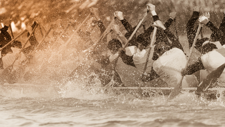 Close up of rowing team race with vintage color tone