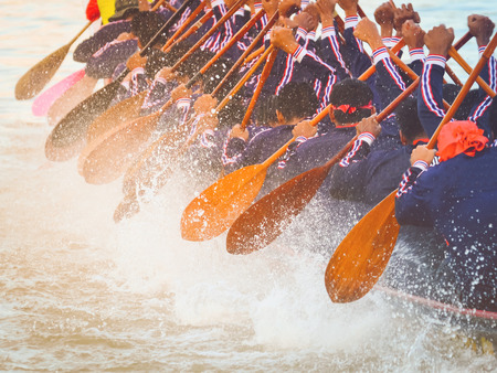 Close up of rowing team race
