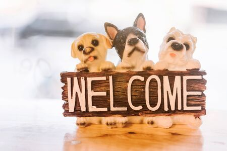 animal figurines: toy dog and welcome