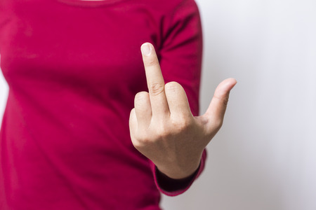 middle finger: Bad woman is showing fuck off with the middle finger