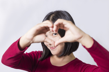 girl portrait: Woman show heart hands