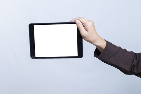 blank tablet: Businesswoman with Blank Tablet for Advertising: CU Hand Holding Tablet
