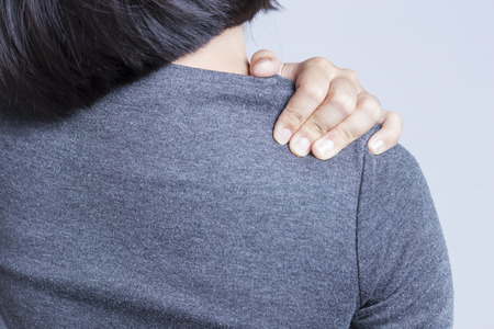 hand on shoulder: Office Syndrome: Shoulder Pain Stock Photo
