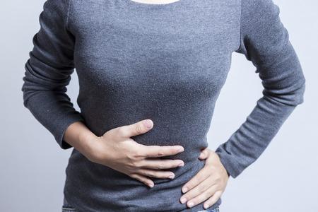 Mujer Dolor de estómago Foto de archivo - 46620414