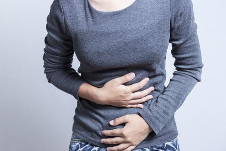 ragazza malata: Donna Mal di stomaco Archivio Fotografico