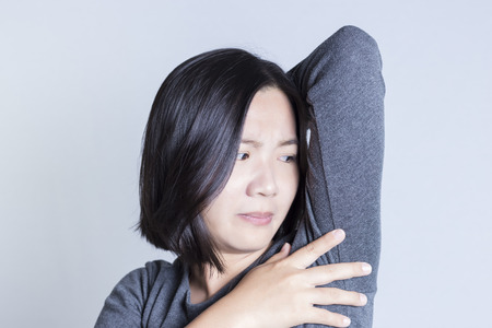 Women worry about body odor 版權商用圖片