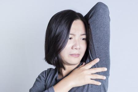 Women worry about body odor 版權商用圖片