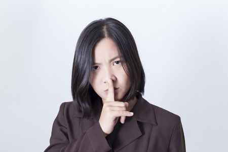 silence gesture: Business Woman Making Silence Gesture
